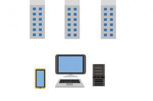 複数の証券会社ビルとパソコン 複数の証券口座を開設のイメージ